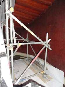 The scaffolding rests on the floor at each side of the Staircase so there is no extra loading on the stairs.