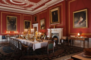The Dining Room at Attingham Park, Shropshire showing the candelabras on the main table and the replica Argand lamps on the side tables.
